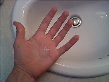 English: Liquid antibacterial soap on a person...