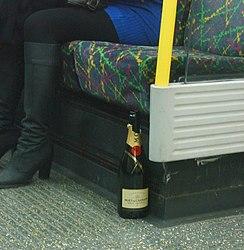 Lonely bottle of Moet on the Tube (2539879473).jpg