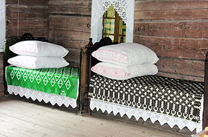 Woven coverlet - Two beds topped by colored coverlets
