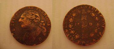 Moneda francesa de 1791. En el anverso aparece el reyLuis XVIcon el epígrafe: «Luis XVI rey de los franceses». El reverso lleva unhaz de lictorcon ungorro frigio, símbolos de la Revolución, y la inscripción «la nación, la ley, el rey».
