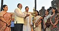 "Mahesh Sharma and the Minister of State for Tourism (IC) and Electronics & Information Technology, Shri Alphons Kannanthanam lighting the lamp at the inauguration of the ""Paryatan Parv"".jpg"