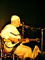 Man playing a guitar and singing at a concert in Burkina Faso, 2009.jpg
