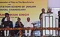Manmohan Singh addressing at the handing over possession of flats under Slum Rehabilitation Scheme of JNNURM at Dhanas, Chandigarh. The Governor of Punjab, Shri Shivraj Patil.jpg