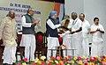 Manmohan Singh felicitating Dr. M.M. Jacob, former Governor and former Union Minister, at a function, in Kochi, Kerala. The Governor of Kerala, Shri Nikhil Kumar.jpg