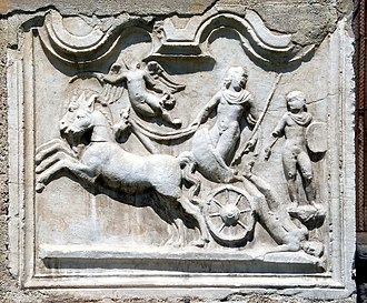 October Horse - Imperial Roman funerary relief showing a spear-bearing Achilles in a lunate biga, dragging the body of Hector, with a winged figure above