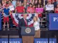 Marsha Blackburn and Donald Trump waving at Nashville Rally.png