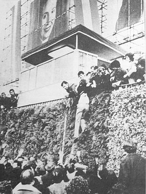 Ezeiza massacre - A person being pulled up on the platform where Peron would have talked.