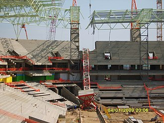 Mbombela Stadium - A freak storm on the evening of 4 Jan 2009 blew over a construction tower crane which crashed through the partially completed roof structure and the concrete setaing terraces structures.  This is the internal view.