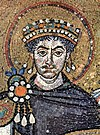 Mosaic of mustachioed, curly-haired man wearing crown and surrounded by halo