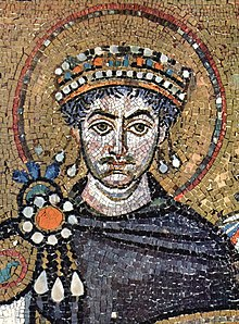 Mosaic depicting the bust of a severe-looking man wearing a crown and an intricate royal purple tunic.
