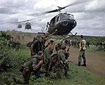 Members of 5 Platoon 7 RAR waiting for US Army helicopters in August 1967.JPG