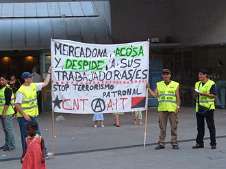 Confederación Nacional del Trabajo - CNT members picketing outside a Mercadona store in Barcelona, June 2006.