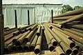 Metal tubes stored in a yard.jpg