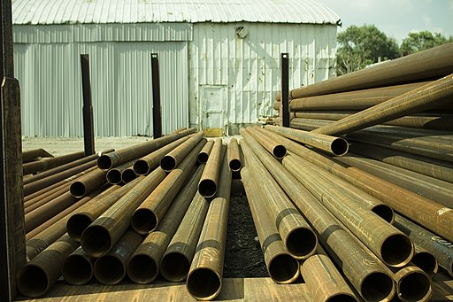 Metal tubes stored in a yard
