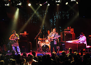 Funk - The rhythm section of a funk band—the electric bass, drums, electric guitar and keyboards--are the heartbeat of the funk sound. Pictured here is the Meters.