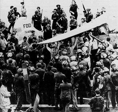 Midway crew surround Major Buang and his family
