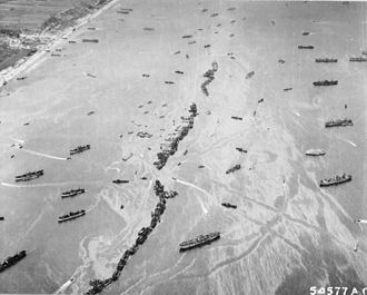 Invasion of Normandy - Off Omaha Beach, American Liberty ships – 'Corn Cobs' were scuttled to provide a makeshift breakwater during the early days of the invasion.