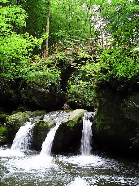 The Schiessentümpel waterfall in the valley of the Ernz Noire in the Mullerthal region in Luxembourg.