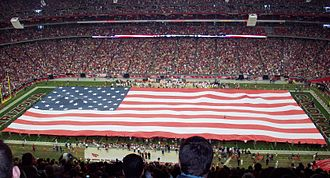 2009–10 NFL playoffs - The presentation of the flag and singing of The Star-Spangled Banner before the start of the Packers vs. Cardinals Wild Card Game.