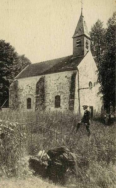 an old picture postcard of the chapel with two people in the foreground