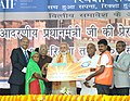Narendra Modi distributing the RuPay Cards to the beneficiaries under Pradhan Mantri Jan-Dhan Yojana, at the function organised by the Rickshaw Sangh, at Varanasi, Uttar Pradesh. The Governor of Uttar Pradesh.jpg