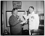 New Chief of Naval Aeronautics takes oath. Washington, D.C., June 1. The newly appointed Chief of Bureau of Aeronautics, U.S. Navy, Capt. John H. Towers, right, being administered the oath LCCN2016875733.jpg