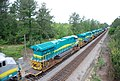 New GE locomotives transported on flat cars for export • 10.jpg