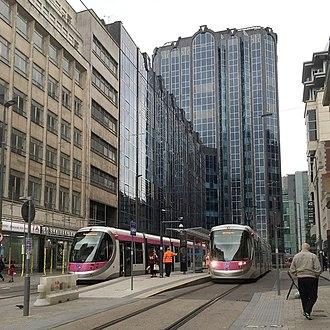 Bull Street tram stop - Urbos 3 trams calling at Bull Street, in May 2016.