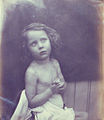 Nude child with hands folded by Margaret Cameron.jpg