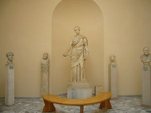 Museo Archeologico Ostiense - A female statue and male busts in the Archaeological Museum of Ostia.