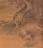 Two boys, an ox and a small ox under a tree.