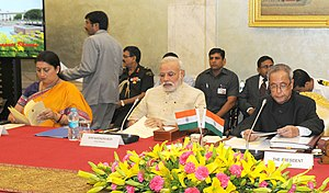 Smriti Irani - Irani, Prime Minister Narendra Modi and President Pranab Mukherjee at the Conference of Chairmen of Boards of Governors, and Directors of IITs at Rashtrapati Bhawan on 22 August 2014.
