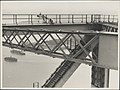 Painters on the arch of the Harbour Bridge, 1932 (8282709213).jpg