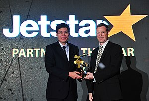 "Lui Tuck Yew - Lui (left), in his capacity as Minister for Transport, presenting the ""Partner of the Year"" award to Paul Daff, Acting CEO of Jetstar Asia Airways, at the Changi Airlines Awards ceremony in Singapore on 10 May 2012"