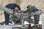 Performing maintenance 140210-N-TW634-029.jpg