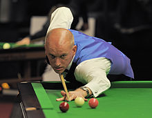 Peter Ebdon playing a shot on the table