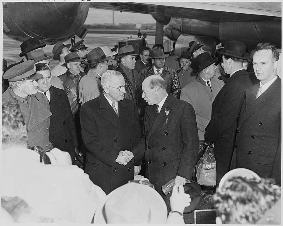 Photograph of President Truman shaking hands with British Prime Minister Clement Attlee at Washington National... - NARA - 200256