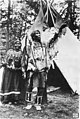 Piegan Blackfeet man named Three Bears and woman standing in front of an open teepee, Glacier National Park, Montana, between (AL+CA 3441).jpg
