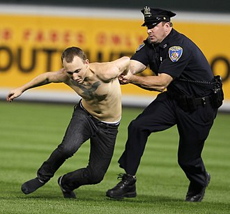 Pitch invasion - A police officer tackles a lone field invader at a 2011 Baltimore Orioles game.