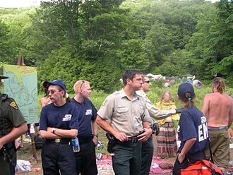 "Rainbow Gathering - Police and medics near ""trading circle"" at the annual U.S. national Rainbow Gathering in West Virginia, 2005"