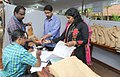 Polling officials collecting necessary inputs required for the Kerala Assembly Election, at the distribution centre, in Nemom, Thiruvananthapuram on May 15, 2016.jpg