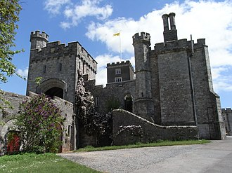 Powderham Castle - Powderham Castle, view of the Victorian entrance tower (left) and causeway from south-west