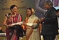 Pratibha Devisingh Patil presenting the Pravasi Bharatiya Samman Award to the Prime Minister of the Republic of Trinidad and Tobago, Mrs. Kamla Persad-Bissessar.jpg
