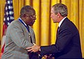 President George W. Bush presents the Presidential Medal of Freedom to Hank Aaron.jpg