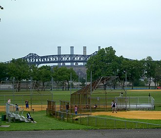 Lincoln Park (Jersey City) - Three of the baseball fields, with Pulaski Skyway and smokestacks of the Kearny Generating Station in background