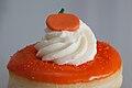 Pumpkin with orange glazing on Halloween doughnut (15456584491).jpg