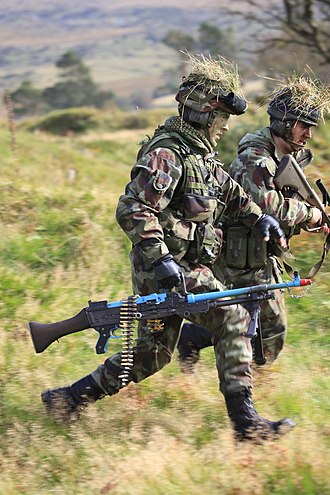 Army Reserve (Ireland) - Army Reservists on a training exercise in the Glen of Imaal carrying a FN MAG GPMG and a Steyr AUG assault rifle