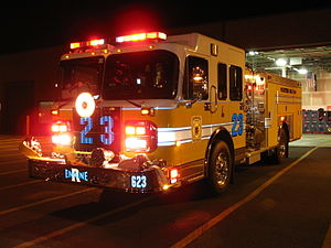 Emergency vehicle equipment - An American fire engine lit up at night.  Notice the use of lights and reflective markings on the vehicle.