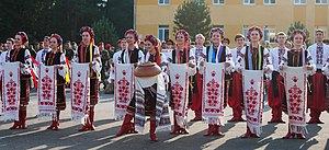 Ukrainian folklore - Traditional Ukrainian clothes, salt and bread and rushnyk.