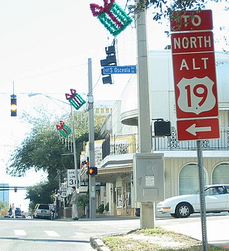 U.S. Route 19 Alternate (Florida) - Red ALT US 19 shield on the southwest corner of Cleveland Street and Osceola Avenue in Clearwater, Florida; December 20, 2003